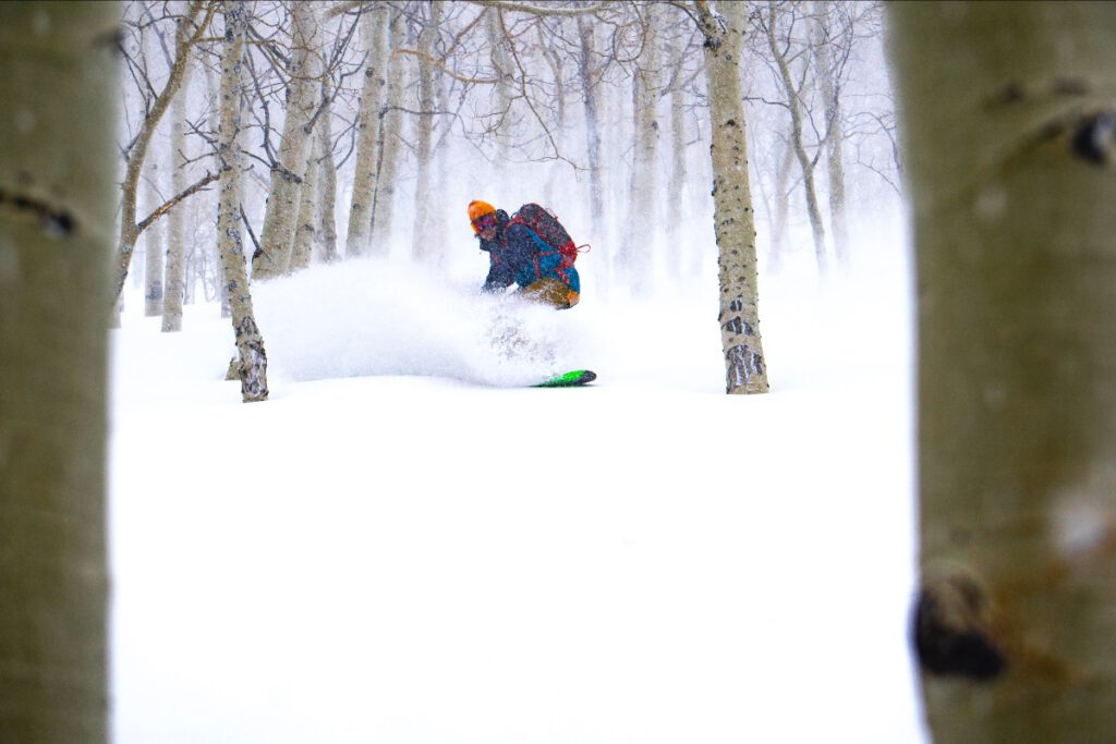 Snowboarder slaying low angle powder through quakies somewhere in the central Wasatch but most likely Mill D North Fork.
