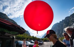 Wasatch Backcountry Alliance board member Dani Poirier holds weather balloon at Save Our Canyons' balloon event in Little Cottonwood Canyon. Photo credit: Salt Lake Tribune